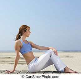 Middle aged woman relaxing at the beach