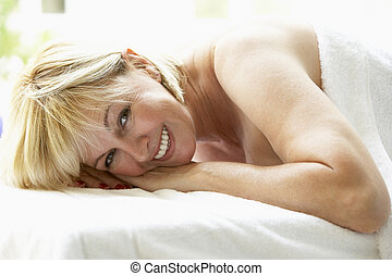 Middle Aged Woman Relaxing On Massage Table
