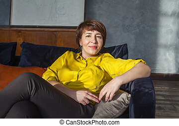 Middle aged woman resting at home