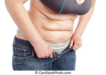 Middle-aged woman shows belly with excess fat. On a white...