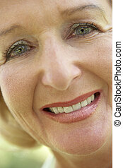 Middle Aged Woman Smiling At The Camera