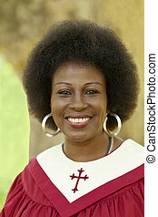 Middle-Aged Woman Smiling Outdoors Red Church Robe