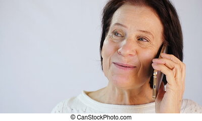 Middle aged woman speaking by the phone