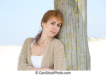Middle aged woman standing at the beach