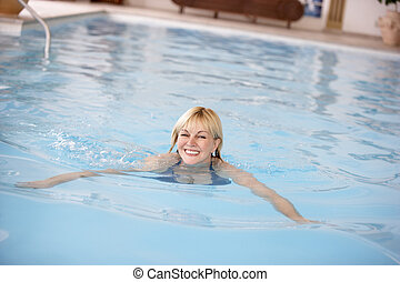 Middle Aged Woman Swimming In Pool