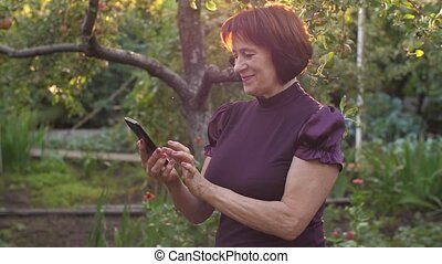 Middle aged woman using cell phone - Eldery woman with cell...