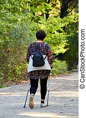 Middle-aged woman walking in park