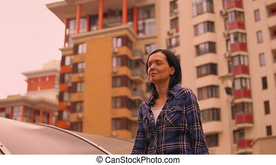 middle-aged woman walking through the residential quarter -...