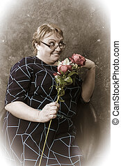 Middle aged woman with flowers vintage style studio portrait