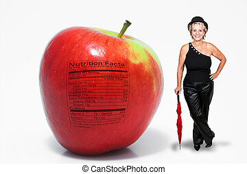 Middle Aged Woman with Red Delicious Apple with Nutrition...