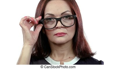 Middle aged woman with spectacles flirts in embarrassment. White background