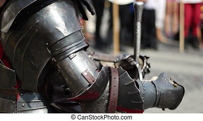 Dark steel knight armor with armrests and spurs, very heavy.