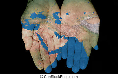 Map painted on hands showing concept of having the Middle East in our hands
