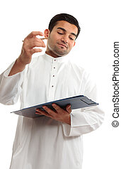 Middle eastern business man writing - An ethnic middle...