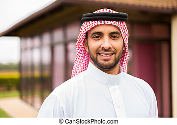 middle eastern man outside the house - portrait of middle...
