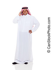 middle eastern man talking on cell phone isolated on white
