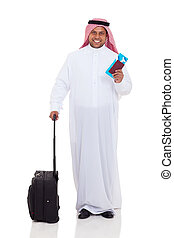 middle eastern man with luggage and air ticket - smiling...