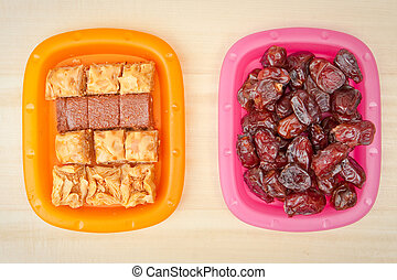 Middle eastern snack - Plates of baqlawa and dates, typical...