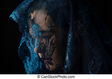 Middle Eastern woman portrait looking sad with blue hijab...