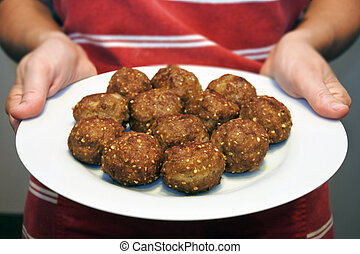 Middle Eastern woman preparing Kibbeh Dish