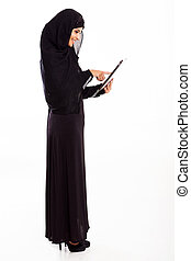 Middle eastern woman using tablet computer