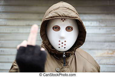 middle finger - anonymous man with plastic mask , criminal...