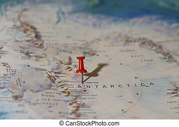 Middle of South Pole Pinned on Map with Red Pushpin - Middle...