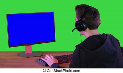 Pro Gamer Playing in Video Games on Mock-up Monitor on a ...
