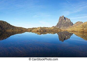 Pyrenees - Midi Dossau Peak reflected in a lake. Ossau ...