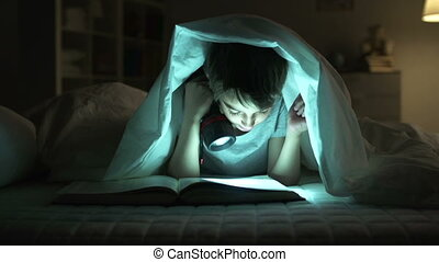 Midnight Studies - Dolly of boy reading aloud in bed
