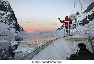Midnight Sun - Adventure tourist and Russian Icebreaker in the Lamaire Channel in Antarctica.