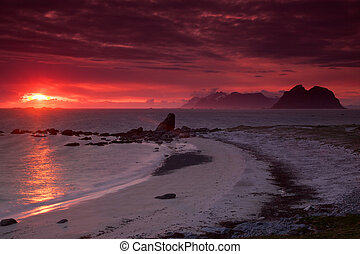 Midnight sun on island of Vaeroy, Lofoten islands, Norway