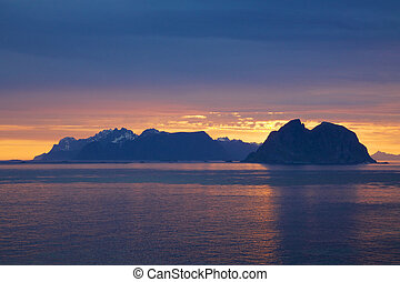 Scenic Lofoten islands in Norway lit by midnight sun during polar day