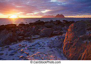 Scenic view of midnight sun on the beach of Lofoten islands in Norway