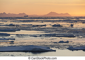 Midnight Sun and sea ice off the coast of eastern Greenland.