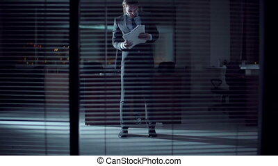 Midnight Work - Man tossing documents and dancing in the...