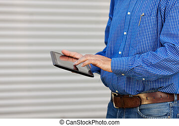 Midsection Of Architect Using Digital Tablet