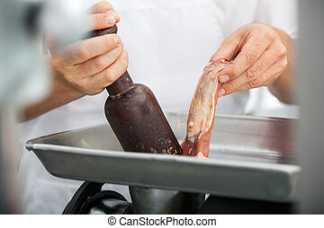 Midsection Of Butcher Using Mincing Machine