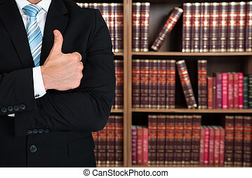 Midsection Of Lawyer Gesturing Thumbs Up