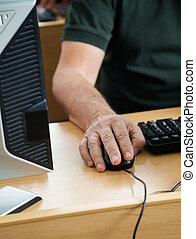Midsection Of Senior Student Using Desktop PC