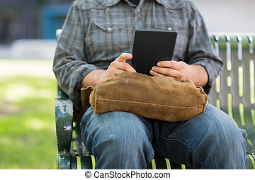 Midsection Of University Student Using Digital Tablet