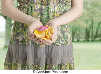 Midsection View of Young Woman Holding Petals