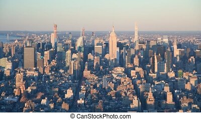 Midtown Manhattan aerial panoramic view at sunset in slow motion, New York City