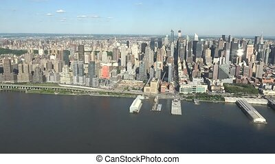 Midtown Manhattan And Piers On River