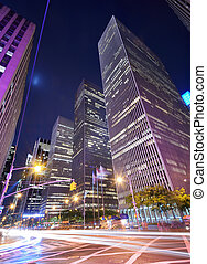 Midtown Manhattan - Office buildings at night along 6th...