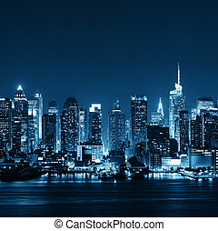 Midtown Manhattan skyline at dusk panorama over Hudson River...