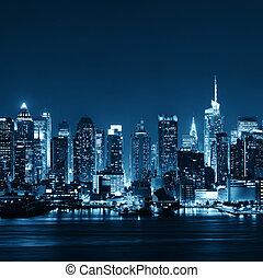 Midtown Manhattan skyline at dusk panorama over Hudson River...