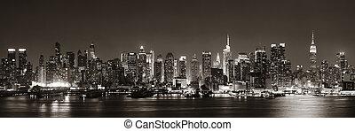 Midtown Manhattan skyline in black and white at dusk...