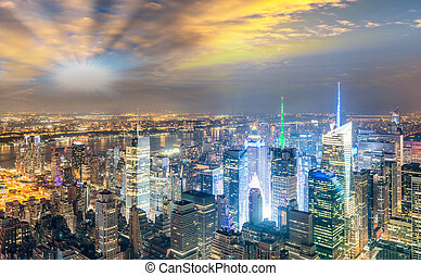 Midtown Manhattan skyscrapers night lights, aerial view of New York City