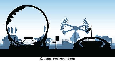 Silhouettes of amusement park rides.